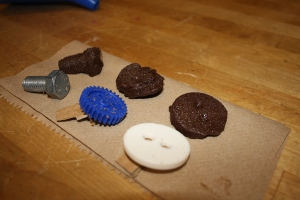 Chocolates made by sandcasting with brown sugar.